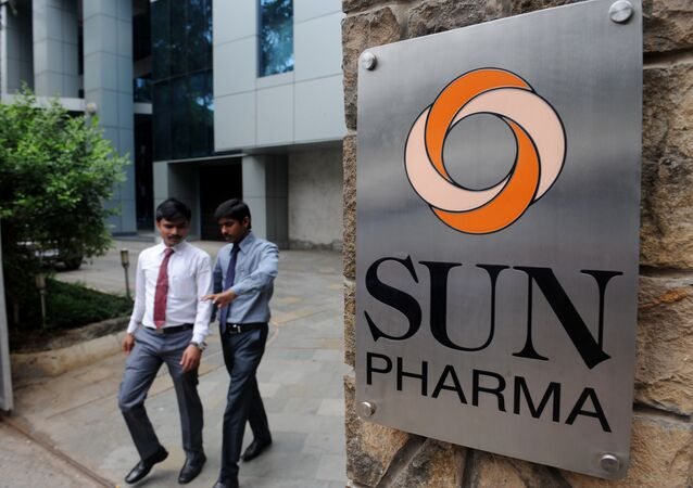 Indian employees of the country's third-biggest drugs company Sun Pharma walk outside its research and development centre in Mumbai. (File)