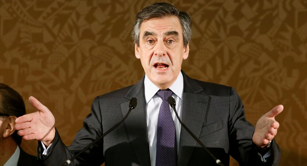 Francois Fillon, candidate in Sunday's second round of the French center-right presidential primary elections, members of the conservative Les Republicains political party, delivers a speech during a meeting with deputies in Paris, France, November 22, 2016.