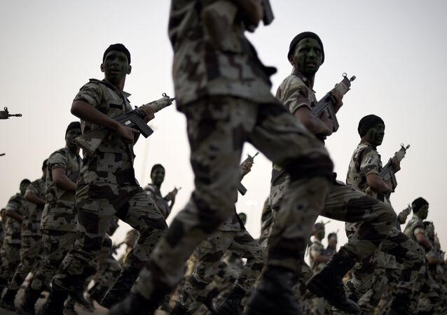 Members of the Saudi special police unit march during a military parade in Mecca on September 17, 2015.