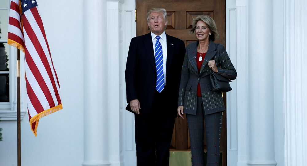 US President-elect Donald Trump (L) stands with Betsy DeVos after their meeting at the main clubhouse at Trump National Golf Club in Bedminster, New Jersey, US, November 19, 2016.