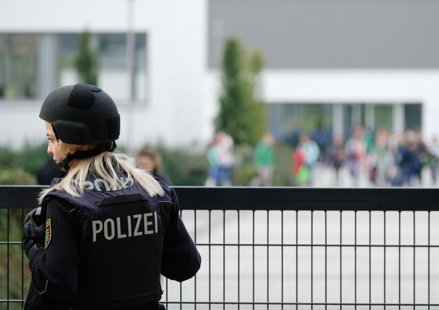 A police woman stands in front of a grammar school in Leipzig, eastern Germany, on October 17, 2016