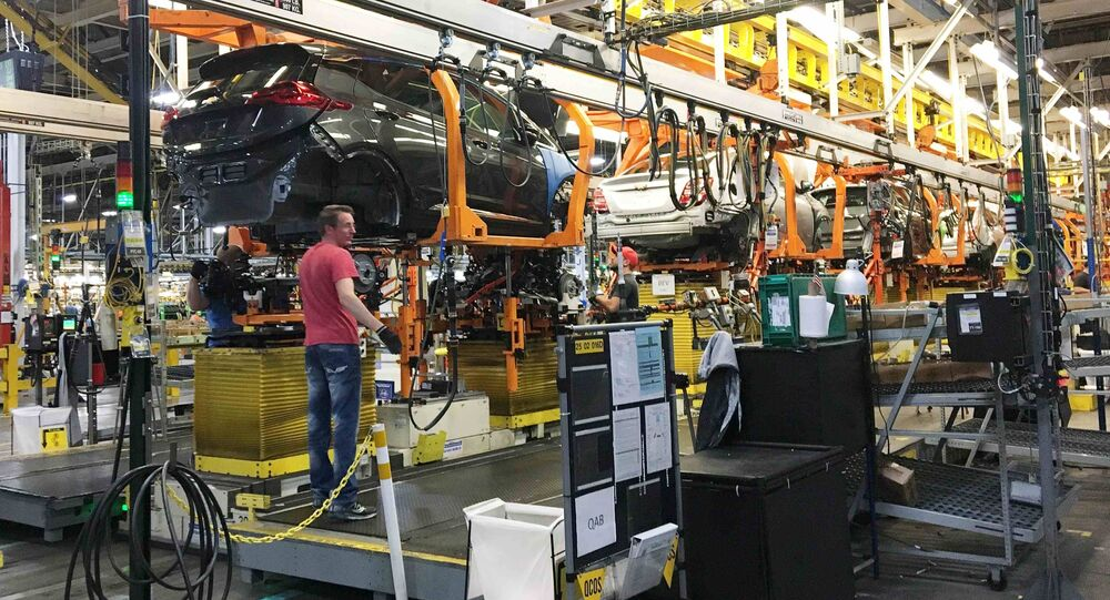 Workers assemble Chevy Volt EV cars at the General Motors assembly plant in Orion Township, Michigan, U.S. November 4, 2016