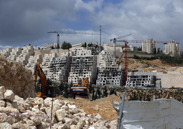 A general view taken on March 29, 2016 shows Israeli construction cranes and excavators at a building site of new housing units in the Jewish settlement of Neve Yaakov, in the northern area of east Jerusalem