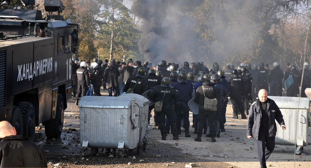 Bulgarian riot police are seen inside a refugee center during clashes in the town of Harmanli, Bulgaria, November 24, 2016
