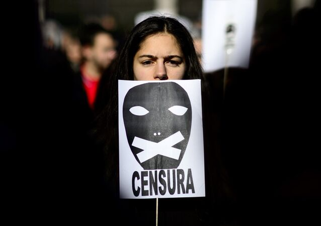 A woman holds a placard reading censorship as she takes part in a demonstration called by the Dignity Marches platform against the new public security law, dubbed ley mordaza (gag law), in Madrid on January 25, 2015