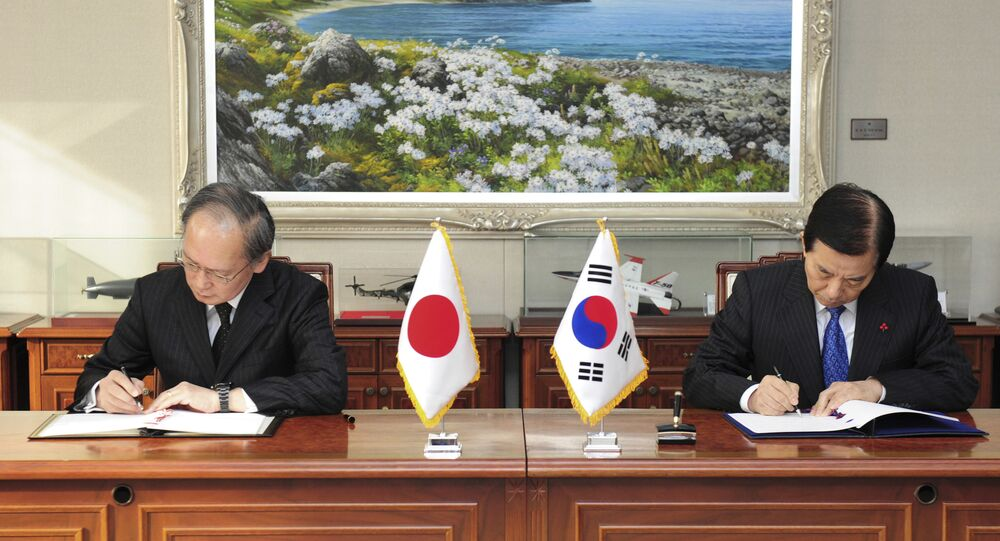 In this photo provided by South Korean Defense Ministry, South Korean Defense Minister Han Min Koo, right, and Japanese Ambassador to South Korea Yasumasa Nagamine sign the General Security of Military Information Agreement on the sharing of military intelligence on North Korea at the Defense Ministry in Seoul, South Korea, Wednesday, Nov. 23, 2016
