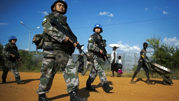 Peacekeeping troops from China, deployed by the United Nations Mission in South Sudan (UNMISS), patrol outside the premises of the UN Protection of Civilians (PoC) site in Juba on October 4, 2016 - Sputnik International