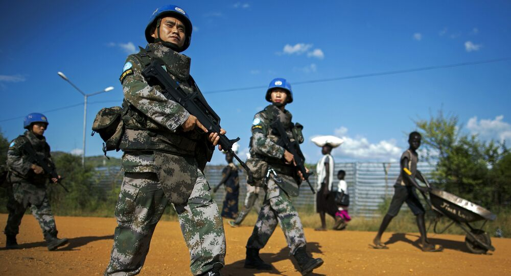 Peacekeeping troops from China, deployed by the United Nations Mission in South Sudan (UNMISS), patrol outside the premises of the UN Protection of Civilians (PoC) site in Juba on October 4, 2016