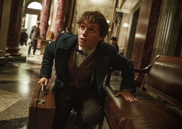 This image released by Warner Bros. Entertainment shows Eddie Redmayne in a scene from, Fantastic Beasts and Where to Find Them.
