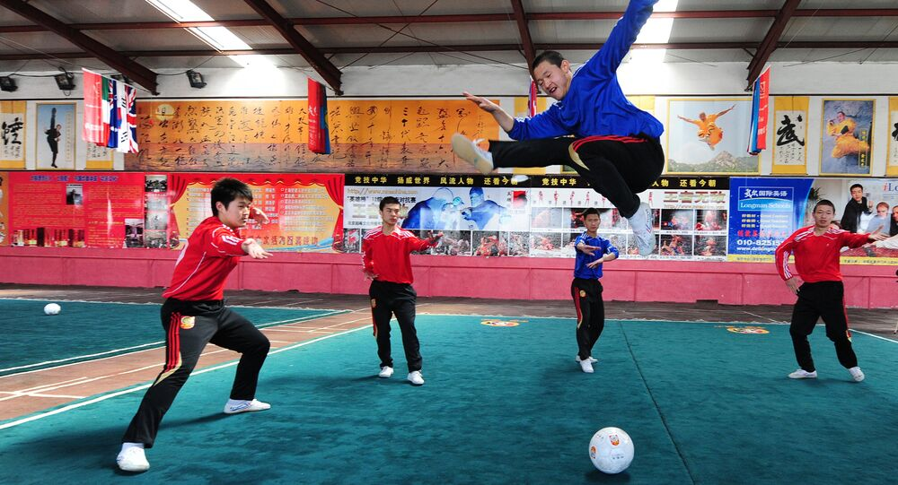 Martial arts students at a Kung fu school in the northern suburbs of Beijing practice their technique leaping over a soccer ball (File)