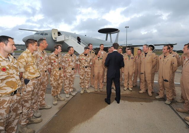 Britain's Deputy Prime Minister Nick Clegg is pictured during a visit to RAF Waddington in Lincoln, north-east England on November 3, 2011, where he welcomed home UK Armed Forces personnel who recently returned from flying or supporting missions as part of the international effort in Libya