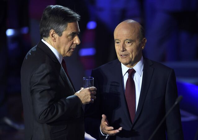 French politicians Alain Juppe, and Francois Fillon arrive on stage to attend the second prime-time televised debate for the French conservative presidential primary in Paris, France, November 3, 2016