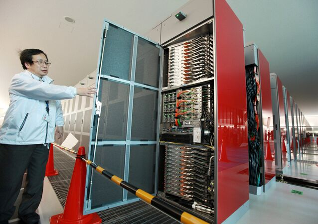 A staff member of Japan's national Riken institute opens a rack of the world's fastest supercomputer named the K Computer at Riken's laboratory in Kobe city in Hyogo prefecture, western Japan on June 21, 2011
