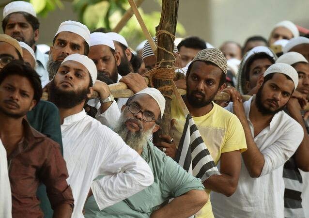 Indian Muslims take part in a protest rally against the implementation of a Uniform Civil Code in Mumbai on October 20, 2016