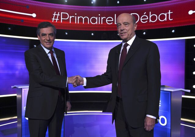 French politicians Alain Juppe (R) and Francois Fillon shake hands as they arrive to attend the third prime-time televised debate as they campaign in the second round for the French center-right presidential primary election in Paris, France, November 24, 2016