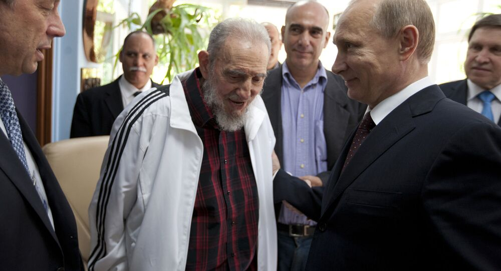 FILE - In this July 11, 2014 file photo, Cuba's Fidel Castro, center, visits with Russia's President Vladimir Putin, right, in Havana, Cuba. Social media around the world have been flooded with rumors of Castro's death, but there was no sign Friday, Jan. 9, 2015, that the reports were true, even if the 88-year-old former Cuban leader has not been seen in public for months