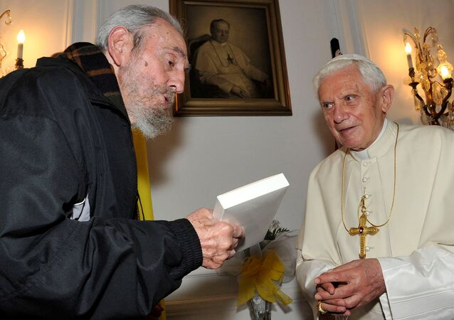 Pope Benedict XVI meets former Cuban leader Fidel Castro in Havana in this March 28, 2012 file photo