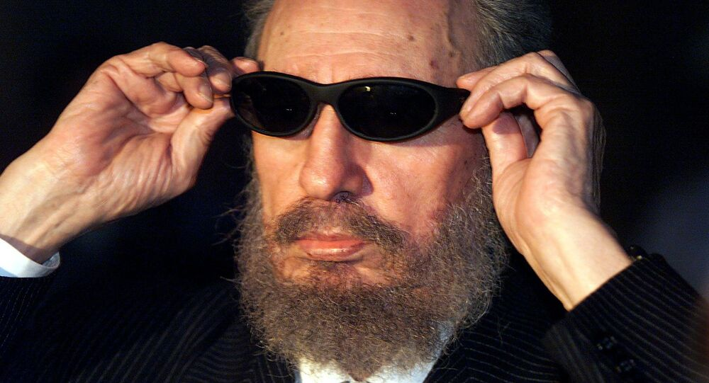 (FILES) This file photo taken on November 16, 1999 shows Cuban president Fidel Castro trying on a pair of sunglasses as he talks to the media 16 November 1999 in Havana, during the IX Iberoamerican Summit. Cuban revolutionary icon Fidel Castro died late Friday in Havana, his brother, President Raul Castro, announced on national television