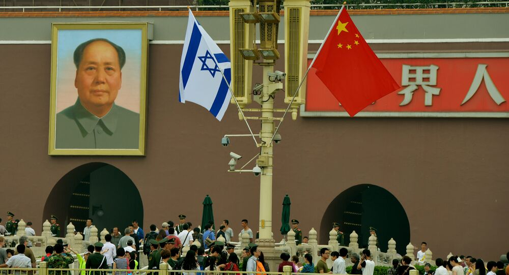 The Israeli and Chinese flags fly beside the portrait of Mao Zedong at Tiananmen Gate in Beijing (File)