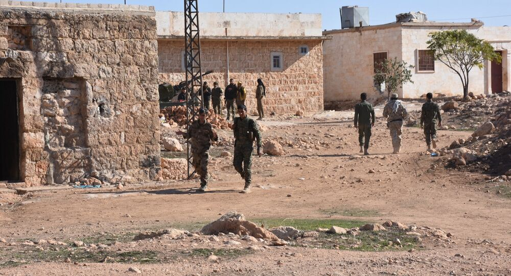Fighter from the Syrian pro-government forces patrol in the recently recaptured village of Joubah during an offensive advancing towards the area of Al-Bab in Aleppo province, on November 25, 2016