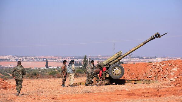Syrian pro-government fighters fire a Russian 122mm howitzer gun as they advance in the recently recaptured village of Joubah during an offensive towards the area of Al-Bab in Aleppo province, on November 25, 2016 - Sputnik International