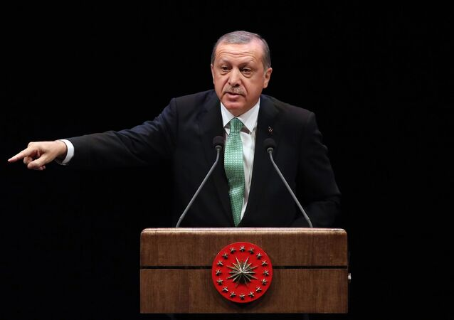 Turkish President Recep Tayyip Erdogan delivers a speech during the Living Human Treasures award ceremony at the Bestepe National Congress and Culture Centre in Ankara on November 3, 2016