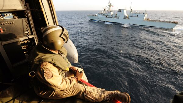Canadian helicopter Sea-King of the military ship Fredericton flies near Canadian military boat during a flying security patrol on January 9, 2010 in the Aden Gulf - Sputnik International