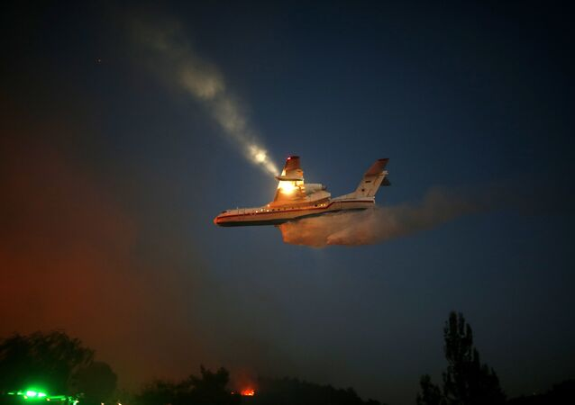 A Russian firefighter plane helps extinguish a new fire that broke out in the Israeli town of Nataf, west of the Arab Israeli town of Abu Ghosh, along the border with the occupied West Bank on November 25, 2016