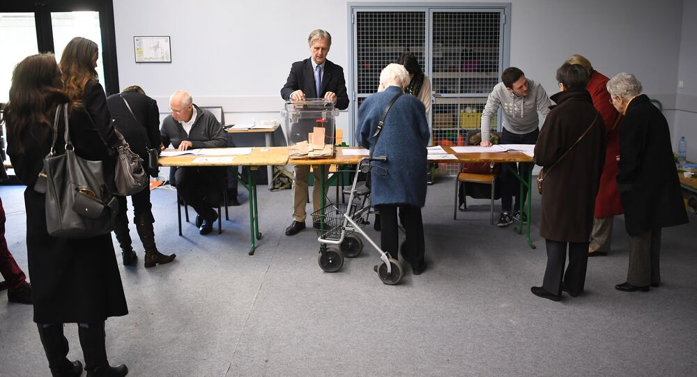People wait to vote at a polling station in Rennes, western France, on November 27, 2016 during the second round of the centre-right primaries ahead of the 2017 presidential election