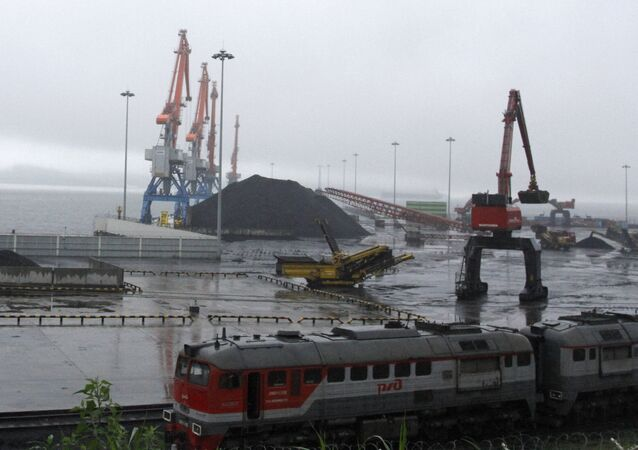 In this July 24, 2016 photo, coal brought from Siberia are be seen awaiting loading onto a ship bound for China in the North Korean special economic zone of Rason