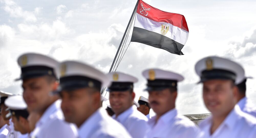 Egyptian soldiers stand as the Egyptian flag is raised on the BPC Anwar el Sadate military cruise ship during the flag ceremony on September 16, 2016 in Saint-Nazaire, western France