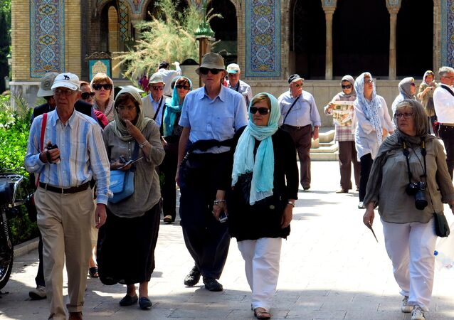 A picture taken on August 5, 2015 shows foreign tourists visiting Tehran's Golestan Palace (The Rose Garden Palace)