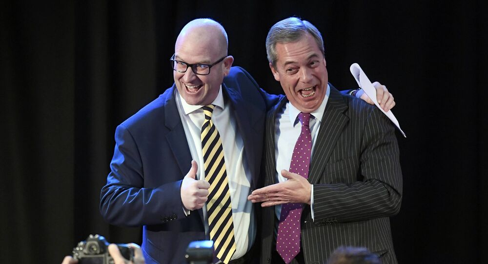United Kingdom Independence Party (UKIP) interim leader Nigel Farage (R) embraces newly elected leader Paul Nuttall, in London, Britain November 28, 2016