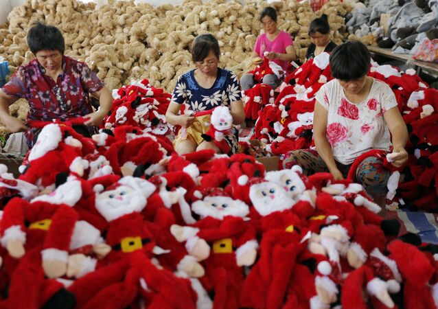 Chinese workers making Santa Claus dolls at a toy factory in Ganyu district in Lianyungang, east China's Jiangsu province