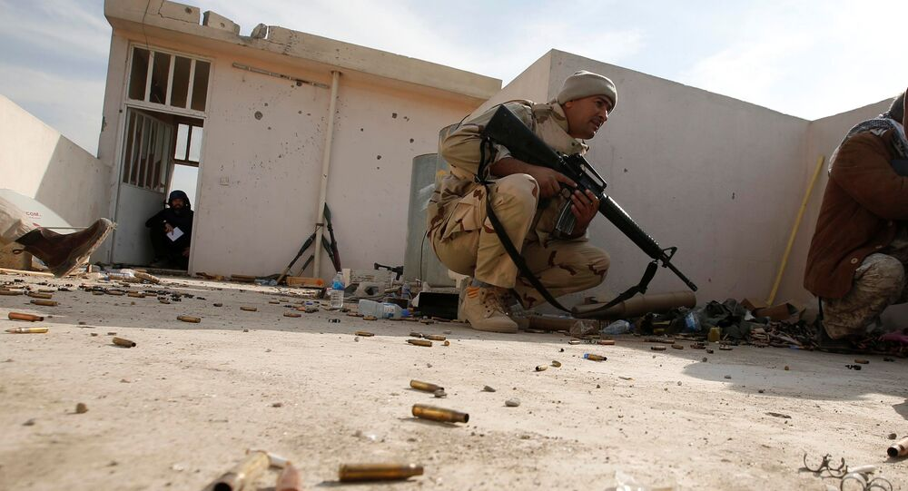 Iraqi soldiers take cover during operation against Islamic State militants in the frontline neighbourhood of Intisar, eastern Mosul November 27, 2016.
