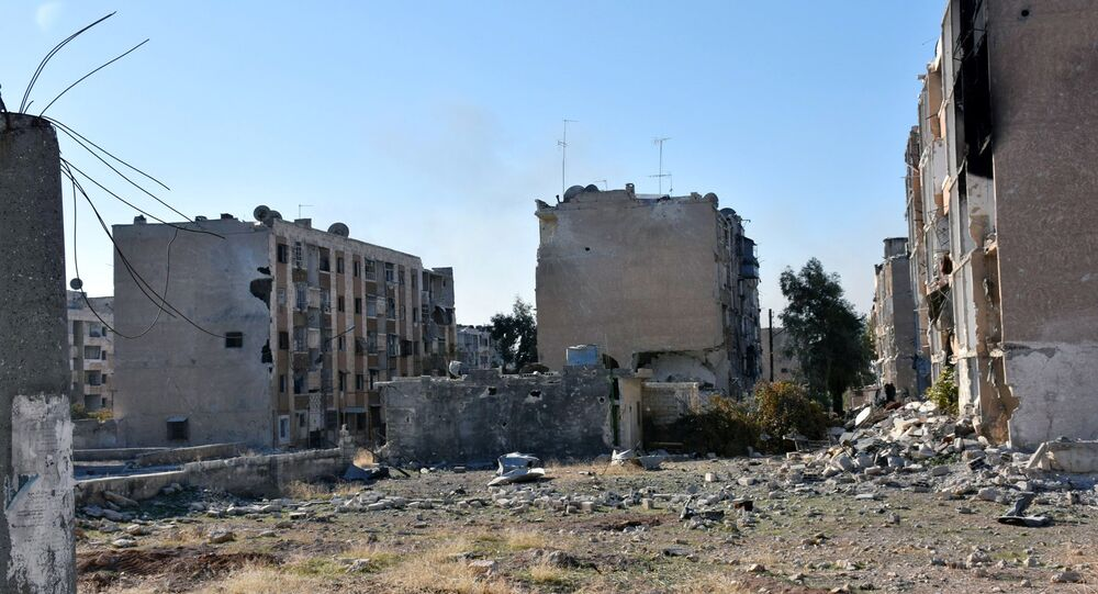 Damaged buildings are pictured in Hanano housing district after government forces took control of the area in Aleppo, Syria in this handout picture provided by SANA on November 27, 2016.