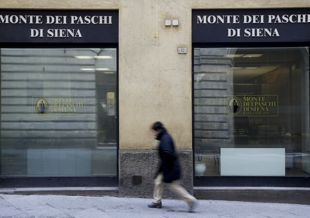 A man walks in front of the Monte dei Paschi bank in Siena, Italy, January 29, 2016.