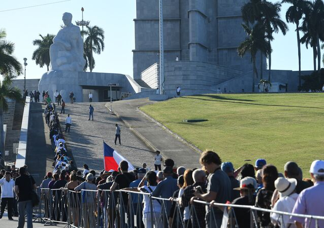 People queue to enter Jose Marti's memorial to pay their last respects to Cuban revolutionary icon Fidel Castro at Revolution Square in Havana