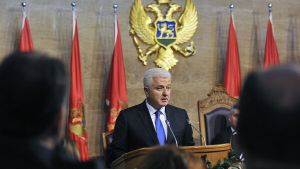 The newly elected Montenegrin Prime Minister Dusko Markovic (C) delivers a speech during a ceremony at the Montenegro Parliament in Podgorica - Sputnik International