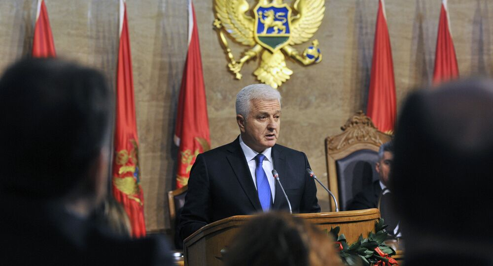 The newly elected Montenegrin Prime Minister Dusko Markovic (C) delivers a speech during a ceremony at the Montenegro Parliament in Podgorica
