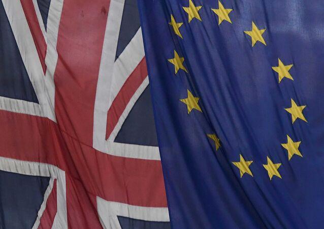 A Union flag flies next to the flag of the European Union in London, Britain, November 4, 2016.