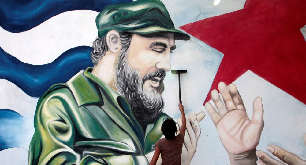 A child plays in front of a mural of late former Cuban leader Fidel Castro at the market in Managua, Nicaragua November 27, 2016.