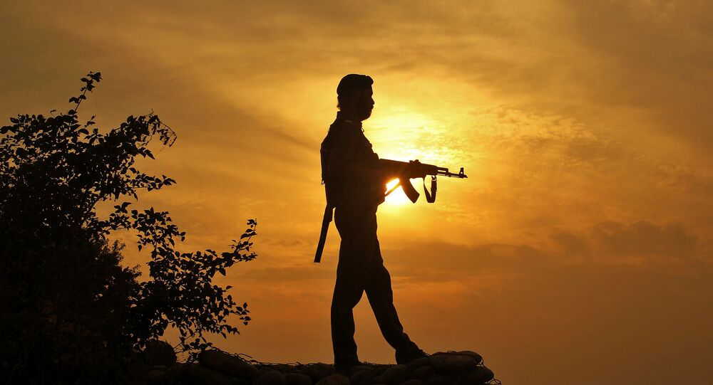 A policeman stands guard outside a police post near Jammu