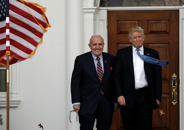 U.S. President-elect Donald Trump stands with former New York City Mayor Rudolph Giuliani before their meeting at Trump National Golf Club in Bedminster, New Jersey, U.S., November 20, 2016