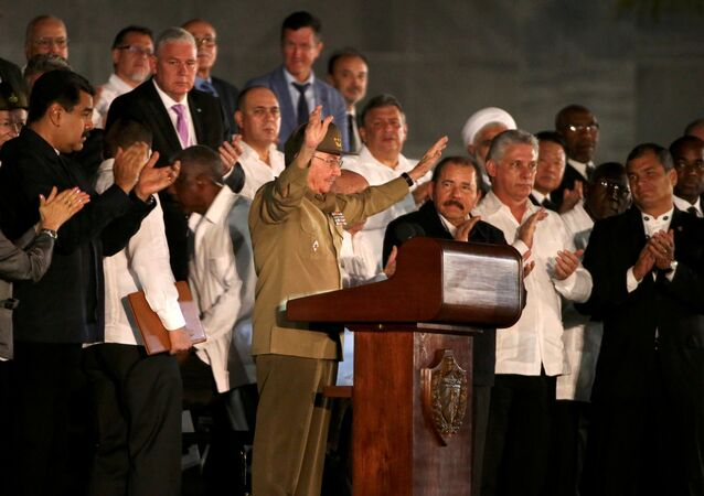 Cuban President Raul Castro acknowledges the applause from the crowd as he attends a massive tribute to Cuba's late President Fidel Castro in Revolution Square in Havana, Cuba, November 29, 2016.