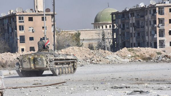 A Syrian government soldier rides a military vehicle near a mosque, after taking control of Aleppo's Al-Haidariya neighbourhood, Syria in this handout picture provided by SANA on November 28, 2016. - Sputnik International
