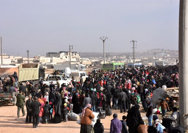 Syrians that evacuated the eastern districts of Aleppo gather to board buses, in a government held area in Aleppo, Syria in this handout picture provided by SANA on November 29, 2016.