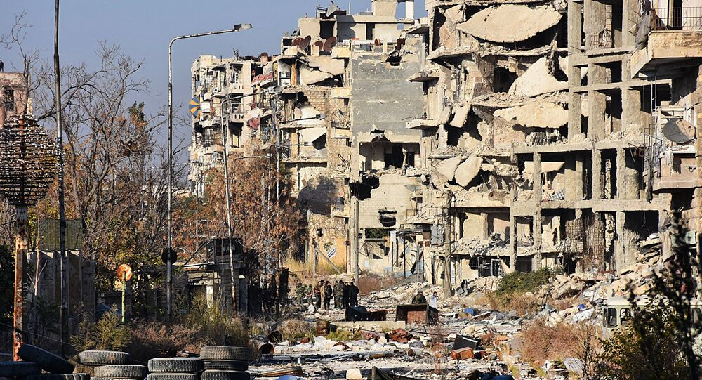 Destruction is seen in Aleppo's Bustan al-Basha neighbourhood on November 28, 2016, during Syrian pro-government forces assault to retake the entire northern city from rebel fighters.