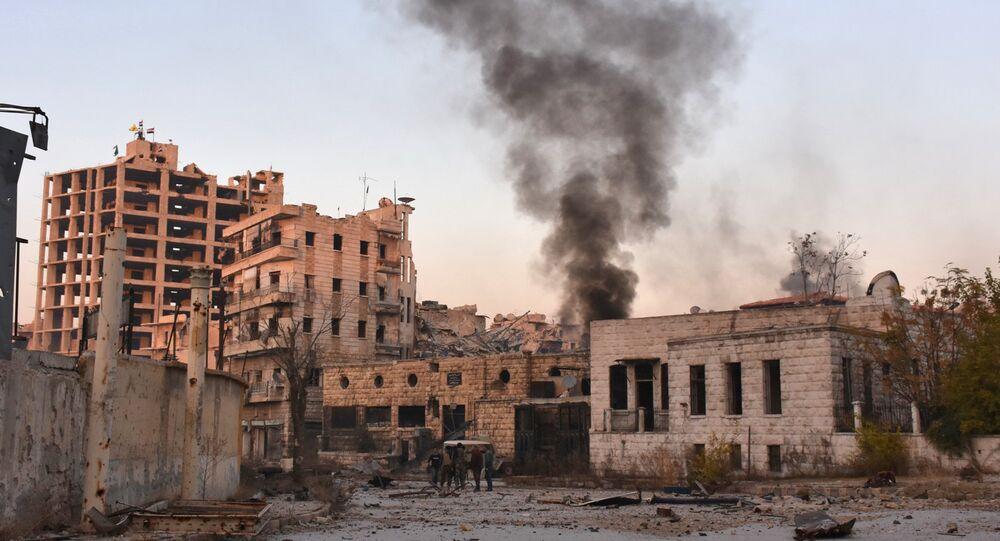 Smoke billows in Aleppo's Bustan al-Basha neighbourhood on November 28, 2016
