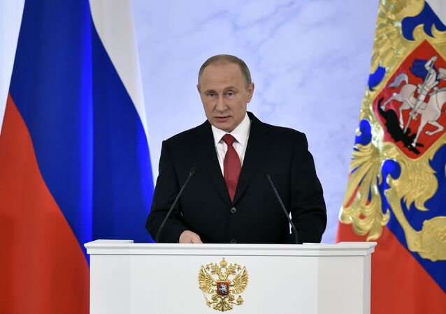 Russian President Vladimir Putin addresses the Federal Assembly of both houses of parliament at the Kremlin in Moscow on December 1, 2016.
